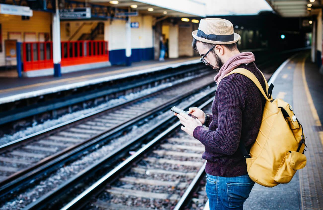 Man on phone at train station